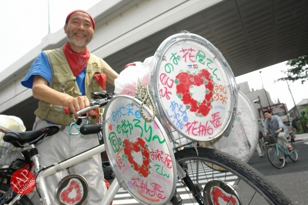 Cheerful cycling man with gay smile, his name is Captain flower (3)