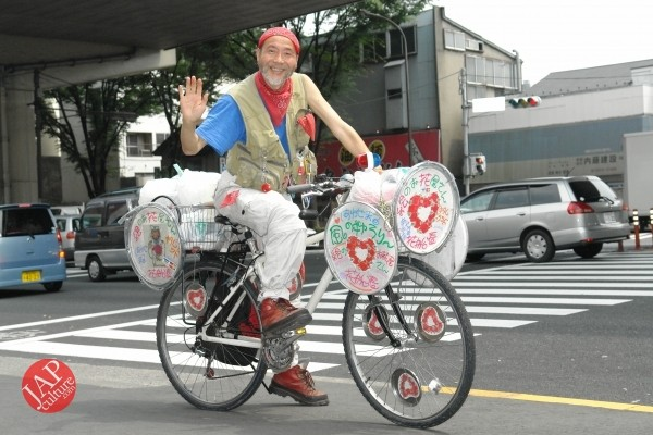 Photo of Cheerful cycling man with gay smile, his name is Captain flower